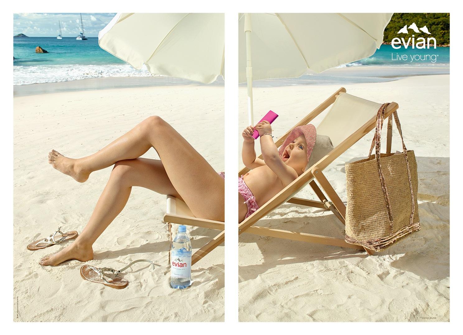 evian-vivons-jeune-femme-mobile-transat-parasol-plage-caraibes