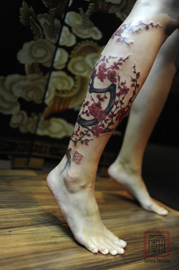 tatouage-jambe-cerisier-fleur
