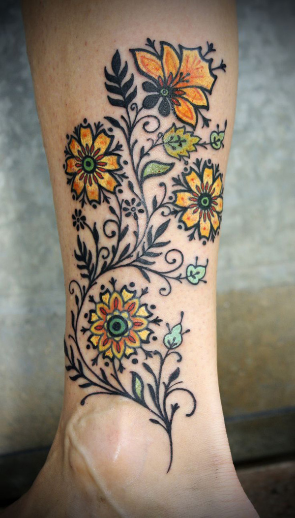 tatouage-jambe-fleurs