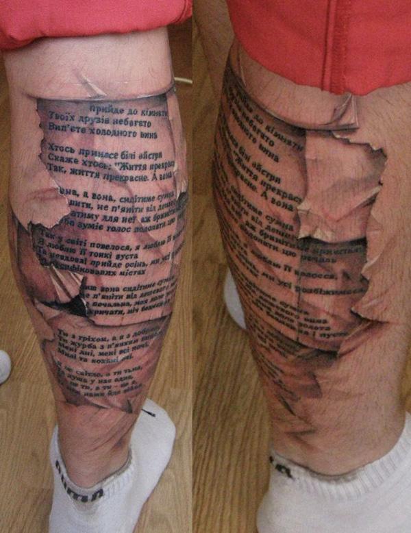 tatouage-jambe-livre-relief